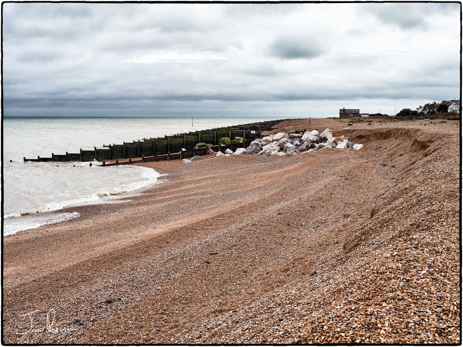 The sea eats away at the shingle no matter how often the bulldozers come around